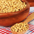 Stock Photo: Soy beans on table on wooden background