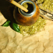 Stock Photo: Calabash and bombillwith yerbmate on old paper background