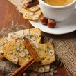 Stock Photo: Cup of tasty coffee with Italian biscuit, on wooden background