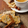Cup of tasty coffee with Italian biscuit, on wooden background — Stock Photo #35006569