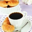 Tasty croissants and cup of coffee on table close-up — Stock Photo #35006587