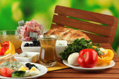 Traditional Turkish breakfast on table on bright background — Stock Photo