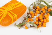 Branches of sea buckthorn with soap isolated on white — Stock Photo