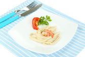 Pasta with shrimps on white plate, isolated on white — Stock Photo