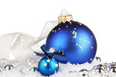 Beautiful blue Christmas balls on snow, isolated on white — Stock Photo