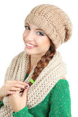 Beautiful smiling girl in warm knit scarf and hat isolated on white — Stock Photo