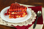 Sweet Belgium waffles with jam, on wooden table background — Photo