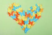 Paper butterflies on green wall — Stock Photo