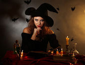 Halloween witch on dark background — Stock Photo