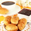 Tasty croissants and cup of coffee on table close-up — Stock Photo #35010943
