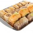 Sweet baklava on tray isolated on white — Stock Photo #35011227
