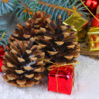 Christmas decoration with pine cones on wooden background — Stok fotoğraf #35014267