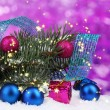 Green Christmas tree with toy and ribbon in the snow on purple — Stock Photo #35018745