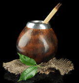 Calabash and bombilla with yerba mate isolated on black — Stock Photo