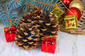 Christmas decoration with pine cones on wooden background — Stockfoto