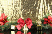 Composition of the Christmas decorations on golden background — Stock Photo