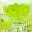 Stock Photo: Tasty jelly cubes in bowl on table on light background