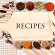 Various spices and herbs with empty wooden board — Stock Photo #35024319