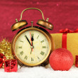 Composition of clock and christmas decorations on bright background — Stock Photo #35028727