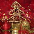 Christmas composition with candles and decorations in red and gold colors on bright background — Stock Photo #35029109