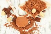 Ahşap masa kaşık toz kakao — Stok fotoğraf