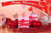 Candles for Valentine's Day on wooden table on red background — Foto de Stock
