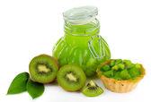 Tasty kiwi jam isolated on white — Stock Photo