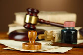Wooden stamp, gavel and old papers on wooden table — Stock Photo