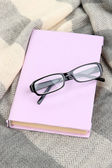 Composition with old book, eye glasses — Stock Photo