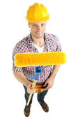 Portrait of young builder isolated on white — Stock Photo