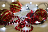 Christmas ornaments and garland — Stock Photo