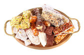 Tasty oriental sweets on metal tray, isolated on white — Stock Photo