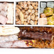 Tasty oriental sweets in wooden crate, close up — Stock Photo