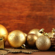 Beautiful Christmas decorations on table on wooden background — Foto de Stock
