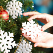 Decorating Christmas tree on bright background — Stock Photo #35081427