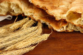 Pita breads with spikes on table close up — Stock Photo