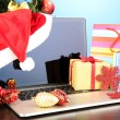 Laptop with gifts on table on blue background — Foto de Stock