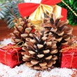 Christmas decoration with pine cones on wooden background — Stock Photo #35147265