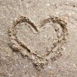 Image of heart, on sand background — Stock Photo