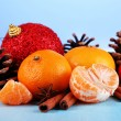 Christmas composition with tangerines on wooden table on blue background — Foto de Stock