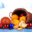 Christmas tangerines and Christmas toys on wooden table on snow background — Foto de Stock