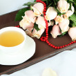 Beautiful bouquet of roses, on wooden tray, on light background — Stock Photo #35147807