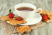 Cup of tea with cookies on table close-up — Stock Photo