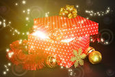 Gift box with bright light on it on bright background — Stock Photo