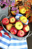 Juicy apples in basket on table close-up — Stock Photo