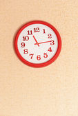 Clock on wall background — Stock Photo