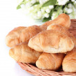 Tasty croissants on wicker mat isolated on white — Stock Photo #35200941