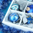 Christmas toys in wooden box close-up — Stock Photo