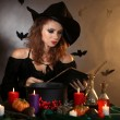 Halloween witch on dark background — Stok Fotoğraf #35202605