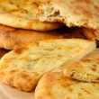 Stock Photo: Pita breads on wooden stand close up
